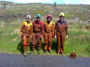 Cavers covered in mud